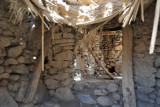 Inside one of the ruined huts
