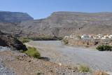 Wadi Ghul with the modern village of Ghul on the right and the summit of Jabal Shams on the left