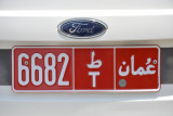 Red Omani license plate