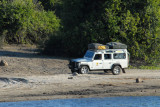 Land Rover of a mobile safari (Bushlore) driving the track along the Chobe River