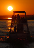 Sunset with a tour boat, Chobe River