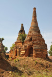 Crumbling ruins of stupas only recentlly freed from the jungle