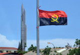 Angolan Flag with the tower of the Mausoleum of Agostinho Neto, MPLA leader then the 1st President of Angola