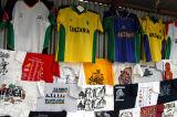 Numerous sidewalk stalls sell t-shirts along Samora Avenue, Dar es Salaam