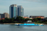 Twin towers of the Bank of Tanzania, Dar es Salaam with a local ferry