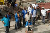 Men waiting at the Stone Town dock, Zanzibar
