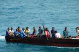 Tanzanian men on a motor launch, Zanzibar