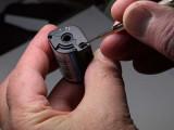 APS Cartridge Door Pawl