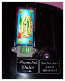 Virgen de Guadalupe light next to the exit signs.