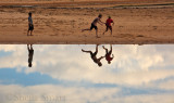 Boys at Narrabeen Lagoon with their reflection