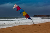Bali flag in storm at Collaroy Beach