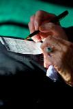Elderly person filling in sudoku