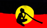 Aboriginal busker in flag