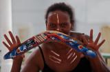Female aboriginal dancer with boomerang