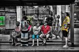 People at bus stop at Quay