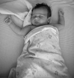 Ava in her crib