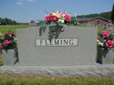 Ozella Fleming 05-01-2000 Ozella Fleming (May 1, 2000) Ozella Fleming of Sweetwater, passed away May 1, at Wood Presbyterian Home. She was a member of Beulah's Chapel Church. She was 91. Preceded in death by: husband, George Lenore (G.L.) Fleming; parents, Patrick and Minnie Jones Newman; and twin grandchildren. Survivors include: daughters-Mrs. James (Mildred) Love of Sweetwater; Mrs. Aline Moore of Niota; Mrs. Kenneth (Jimmie) Foster of Goldsboro, N.C.; Sons-LeRoy Fleming of Sweetwater; Carl Fleming of Niota; and Bryan Fleming of Fairfax, Va.; 15 grandchildren; Seven great-grandchildren; Four great-great-grandchildren; Sister-Audrey Schultz of Savannah, Mo.; Several nieces and nephews. The family will receive friends from 6-8 p.m., Wednesday, in Sweetwater Memory Chapel. Funeral will follow at 8 p.m. with the Revs. Bill Dawson and Hartsell Amburn officiating. Family and friends will meet at Beulah's Chapel Cemetery at 9:50 a.m. Thursday, for a 10 a.m. burial. Memorials may be made to Beulah's Chapel Cemetery, 270 County Road 231, Niota, Tenn. 37826. Sweetwater Memory Chapel, in charge of arrangements.