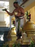 bhattar sprinkling holy water.JPG