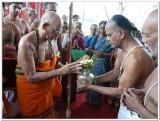 14-HH Sriperumbuthur Embar Jeeyar swamy being received with pOOrna kumbhA mariyAdai.jpg