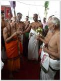 16-HH Sriperumbuthur Embar Jeeyar swamy being received with pOOrna kumbhA mariyAdai3.jpg