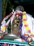 Sri Peyazhwar after receiving Malai and Parivatta mariyadai from Sri Parthsarathi at mylapore.JPG