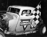 Bob Reuther winning in Tony Formosa's #80 modifed coupe.