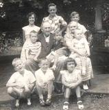 Steve Cavanah setting on Granny Jones lap. The Jones Family. 1950