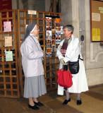 Jacqueline conversing with a nun