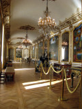 A hallway reminiscent of Versailles
