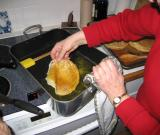 The crêpes dipped in orange-butter sauce
