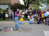 More at the art festival: A juggler playing with fire