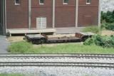 Depressed center flatcar in the weeds behind Hammill Yard