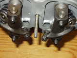 Reinstall pushrods & rocker arm assemblies.