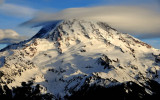 white hat over Mt Rainier