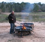 Jon getting the pit ready to cook steaks