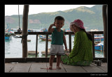 I9675 Nha Trang, little boy with his mother on the porch