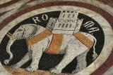 Mosaic-tile elephant within marble panel on floor