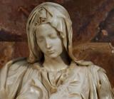 Michelangelo: a youthful Mary for mystery of birth and crucifixion.