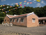 Flags flapping over the Taiwanese farmhouse