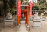 Woman praying at a smaller shrine, Kono-jinja