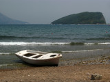 Old boat on the beach with St. Nikola beyond
