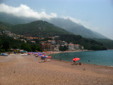 Sveti Stefan beachfront and looming mountains