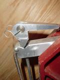 Rear tensioner top lever DIY retaining spring.