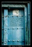 Blue door with welcoming message