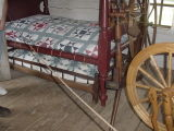 They had trundle beds back in the early 1800s.  See the bed under the main one?  It can be pulled out.