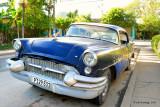 Alone in the street, at Pinar del Rio,Cuba...Maybe 1955 Buick Special 4-Door Sedan?