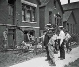 1919 - Whites view destroyed homes of black residents after the riot