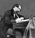 1858 - Charles Dickens at his desk
