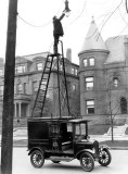 1910 - Changing a light bulb