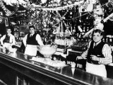 1915 - Babe Ruth (center) tending bar with his father (right)